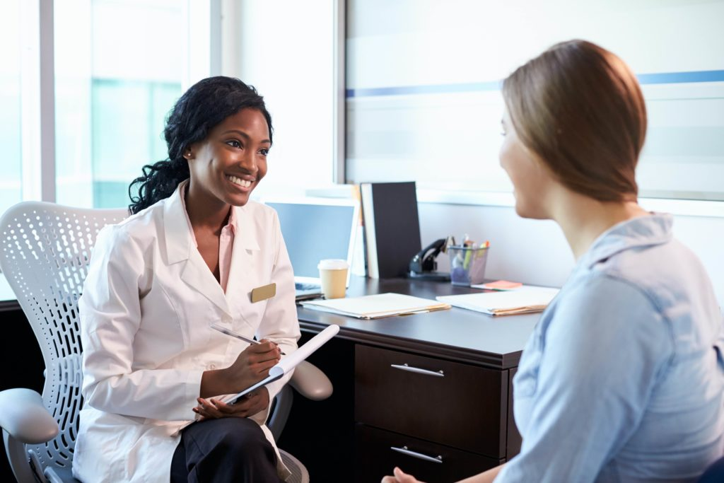 Female Doctor Consulting Female Patient