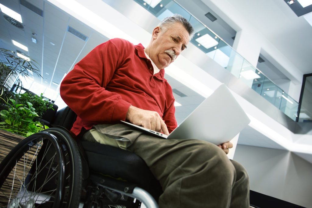 Elderly patient using laptop