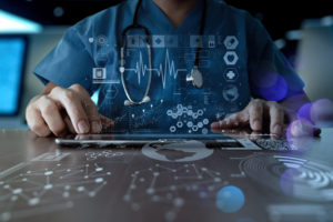 Doctor using technology with overlaid graphics symbolizing trends and data