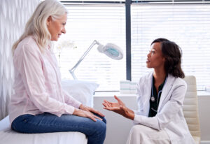 Primary care provider consults patient.