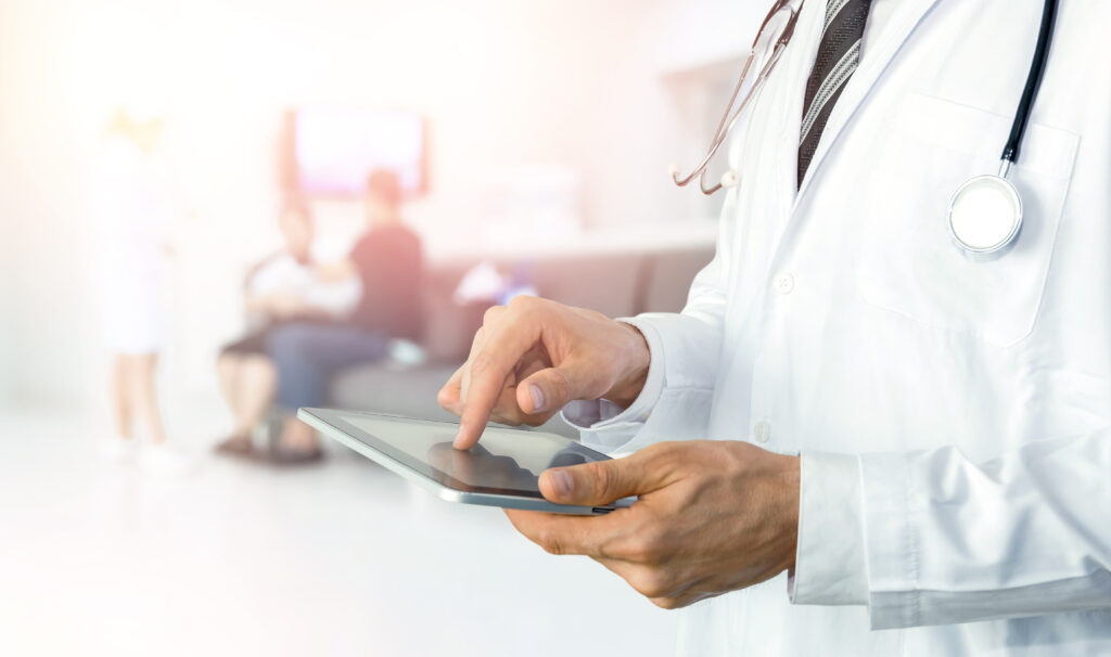 Doctor uses virtual scribe technology before patient visit.